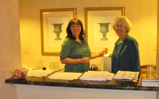 Caroline Goldsmith (L) and Pat Hawkins at the Information Desk